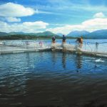 Salmon farmers working on a salmon farm